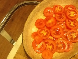 Tomato slices in oven dish