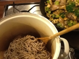 Cooked soba noodles needing oil and toppings