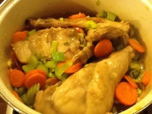 Simmer rabbit with vegetables and bay leaf in white wine.