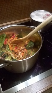 Broccoli and consorts frying in red curry